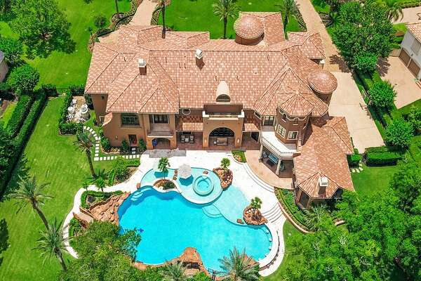 Located at 31 Beacon Hill, this Sugar Land mansion offers a beautiful backyard paradise complete with a 90 foot pool, waterfall, grotto, swim up bar and summer kitchen and patio. At 12,585 square feet, the home boasts six bedrooms, seven and a half bathrooms, home theater, billiards room with a wet bar, personal gym, mother-in-law suite and a custom two-story gentleman's study.