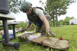 as members of the Montgomery County Hospital District's EMS SWAT team work through emergency scenarios as part of the group's monthly training, Monday, June 10, 2019, in Conroe.
