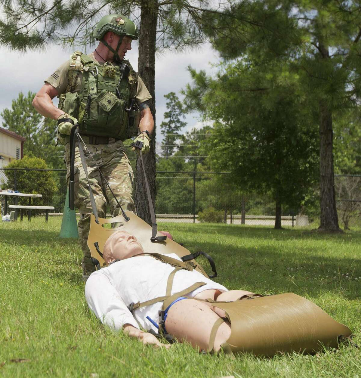 Medic Mike Joublanc transport a manikin after applying a tourniquet as members of the Montgomery County Hospital District's EMS SWAT team takes part in emergency scenarios as part of the group's monthly training, Monday, June 10, 2019, in Conroe.