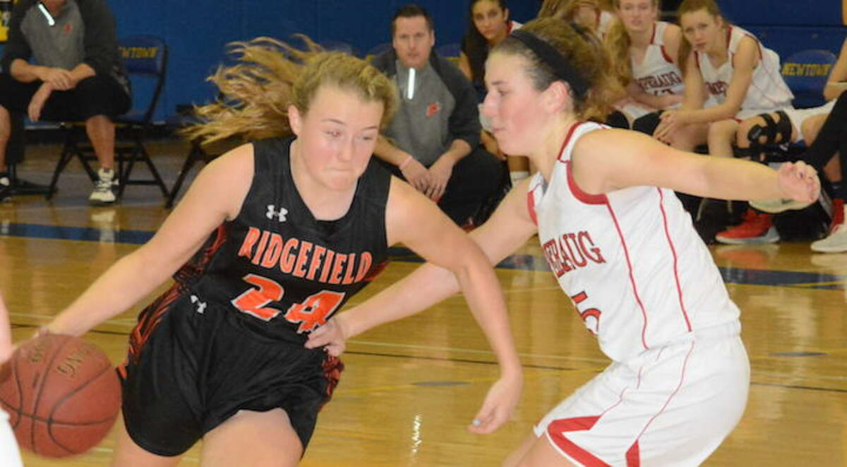 Megan Klosowski looks to drive past a Pomperaug defender during Friday's game at Newtown High. - Andy Hutchison photo