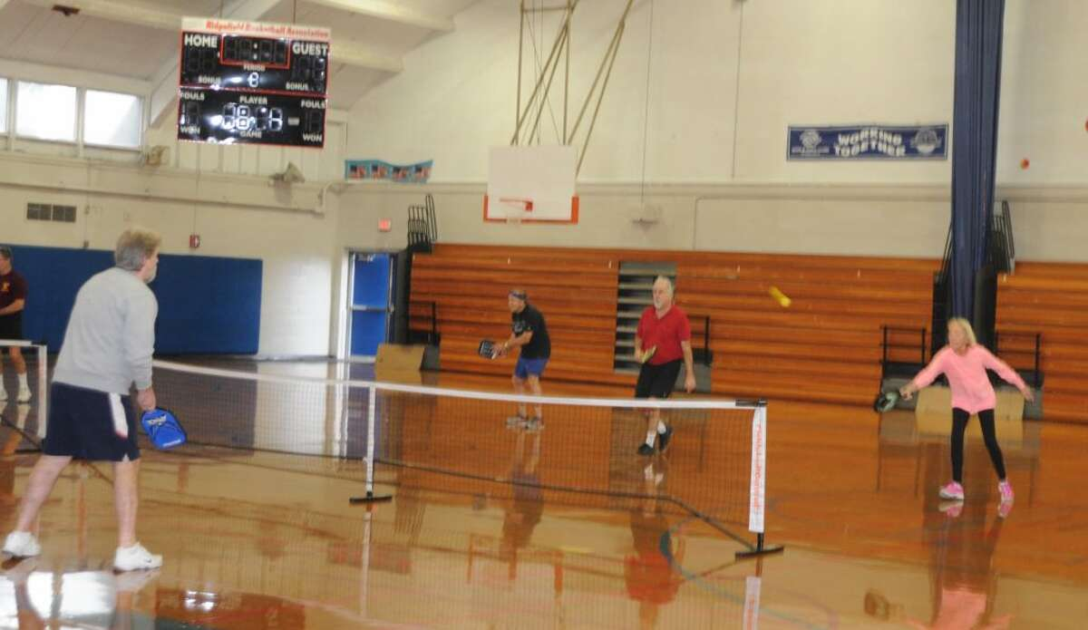 Pickleball players' game is similar to tennis with a lower net, smaller court, and different paddle and balls. These players were on the court Monday, Dec. 17, in Yanity gym. - Macklin Reid photo