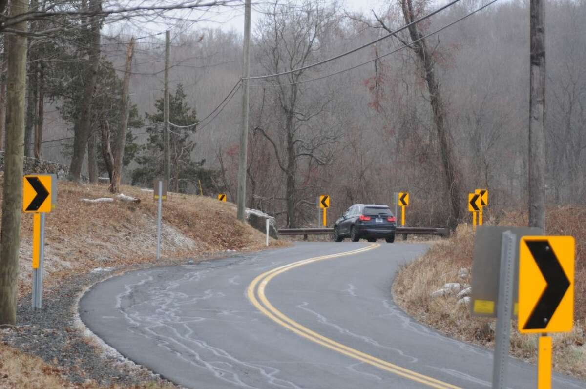 A multitude of arrow signs were put up to help drivers negotiate the big curve on Old Stagecoach Road. - Macklin Reid photo
