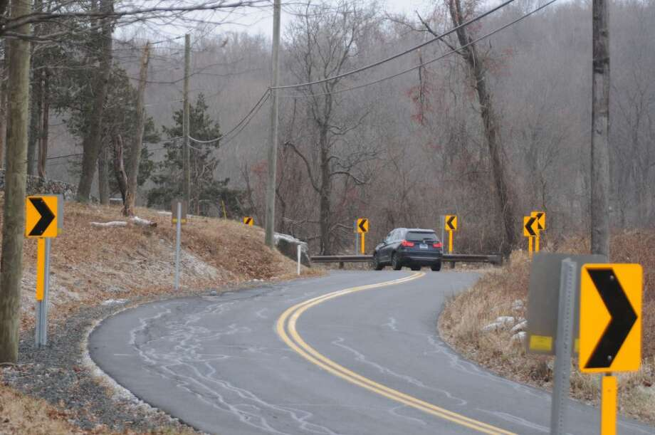A multitude of arrow signs were put up to help drivers negotiate the big curve on Old Stagecoach Road. — Macklin Reid photo