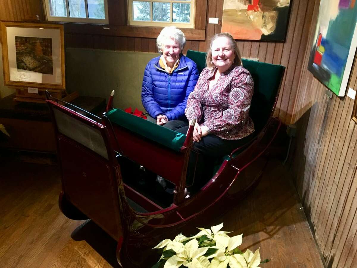Sylvia Pinchbeck Sturges, left, with Hilary Micalizzi, board president, Keeler Tavern Museum and History Center, seated in the antique sleigh that she recently donated.