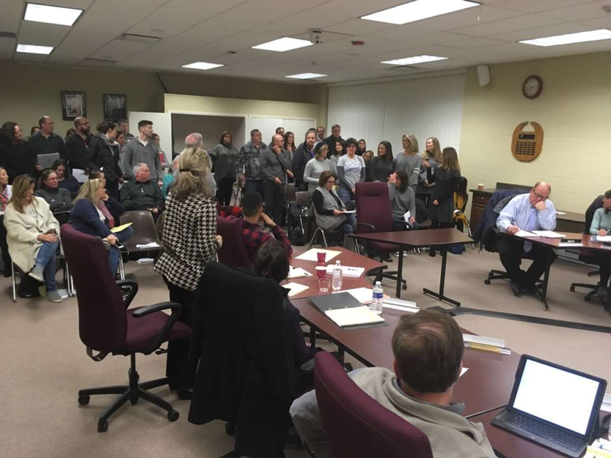 Forty six residents stood up at Monday night's Board of Education meeting to demonstrate that they were against the initiative to start Ridgefield schools later. - Peter Yankowski photo