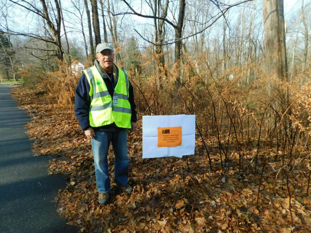 CERT volunteer Roger Rostaino identifies one of the signs placed around town on Dec. 2 as volunteers test Crises Track, a program that will help identify and prioritize damage particularly during a storm.