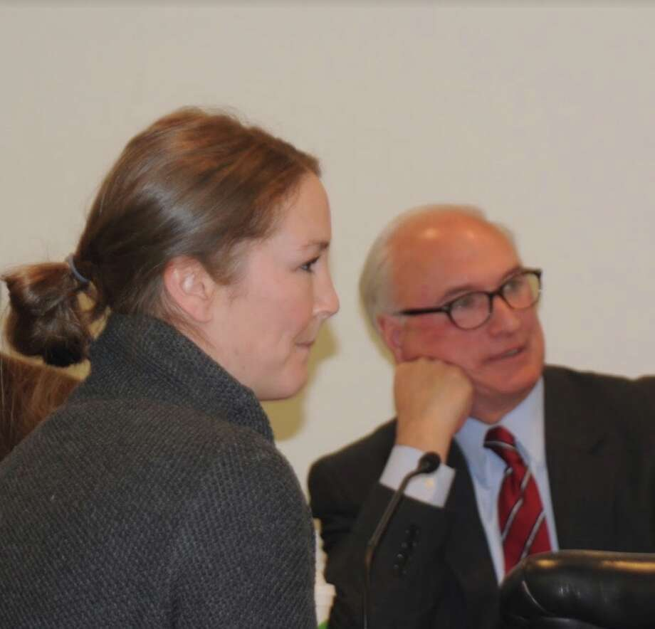 Erica Ippoliti was appointed the Prevention Council at the Nov. 28 selectmen's meeting. Behind is First Selectman Rudy Marconi. — Macklin Reid photo.