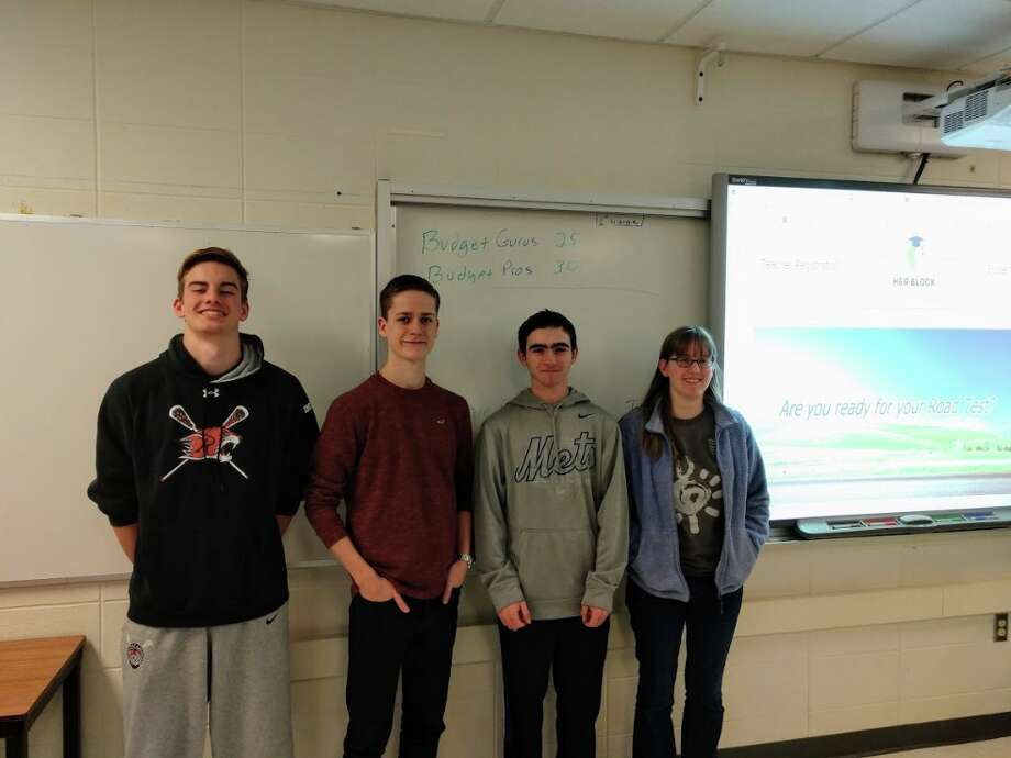 Budget Challenge winners at Ridgefield High School, from left to right: Ray Dearth, RJ Carey, Bobby Arent and Amy Smart.