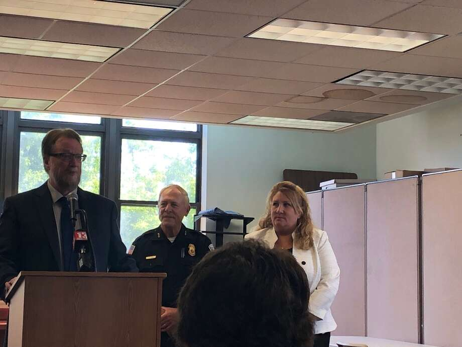 From left, East Greenbush Supervisor Jack Conway, retiring Police Chief Chris Lavin and incoming Police Chief Elaine Rudzinski Photo: Town Of East Greenbush