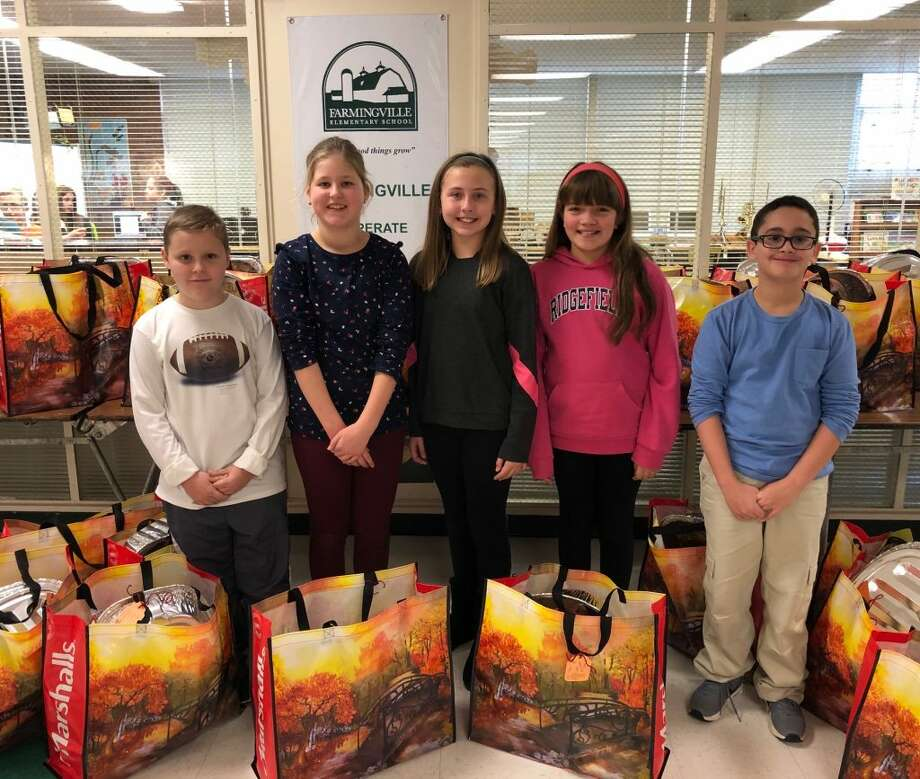 The Farmingville Elementary School community collected and delivered 28 Thanksgiving baskets to the Women's Center of Greater Danbury. Each basket contained a full Thanksgiving feast, including a gift card to purchase a turkey. Since the program started, Farmingville has donated over 150 meals to the Women's Center. Pictured from left to right: Brady Grijns, Lotte Groot, Kylie Lassow, Brenna Williams and Shesh Sheridan.