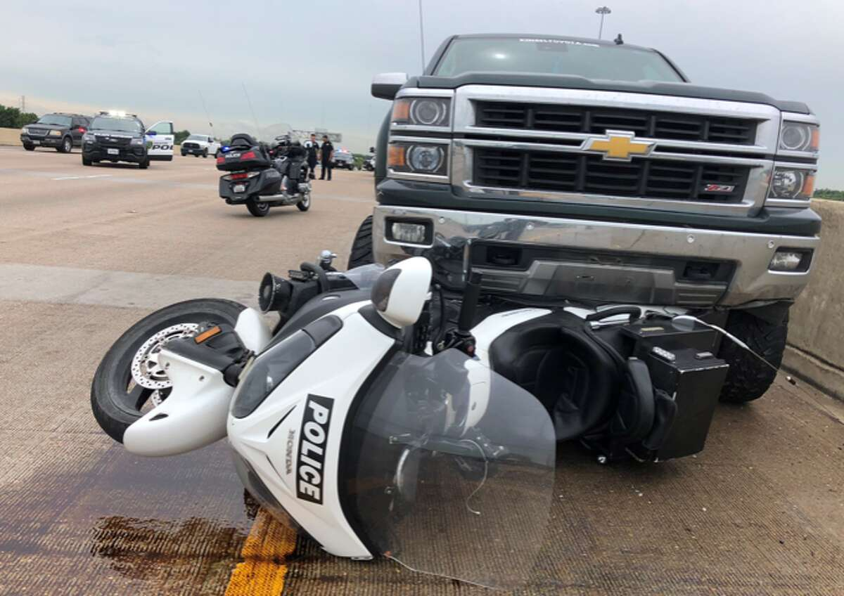 A Roman Forest police officer was hit and dragged by a pickup truck along North Loop 610 on Monday, June 17, 2019 morning.