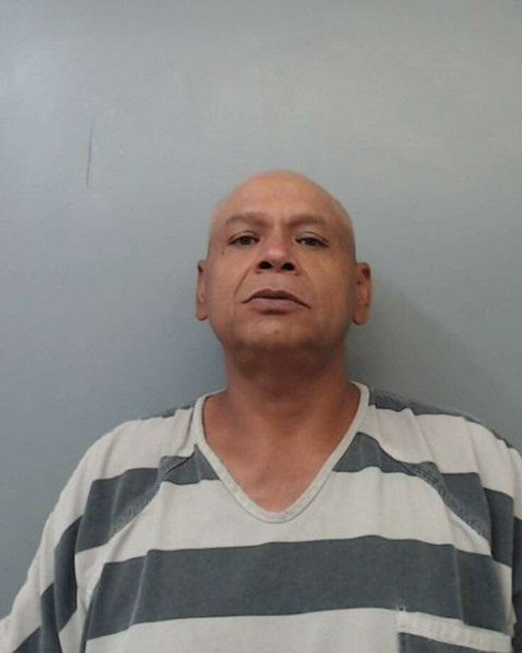 Santos Benavides, 53, was served with arrest warrants that charged him with assault, family violence and interference with an emergency call. Photo: /