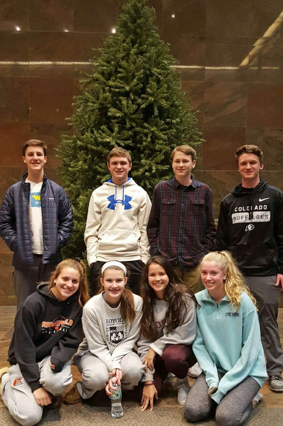 Pictured, in back from left to right are: Full Court Peace members: Finn Atkins, Evan Collins, Sean Maue, and Jason Hartnett. In front, from left to right: Jamie Narcisso, Katie Flynn, Rachel Tomasetti and Kate Garson.