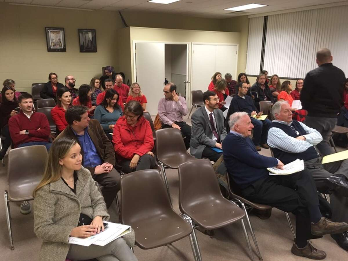 Parents and residents against the start school later initiative turned up at Monday night's Board of Education meeting wearing red clothing. Six people spoke, all of them in opposition to the plan. - Peter Yankowski photo