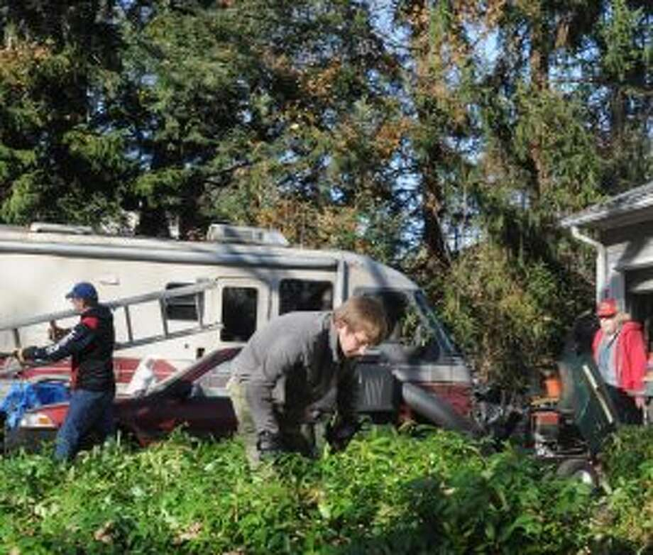 Charlie Kalbfus was part of a St. Mary's cleanup and repair crew of about 50 that helped an elderly couple off North Salem Road on Sunday, Nov. 11.