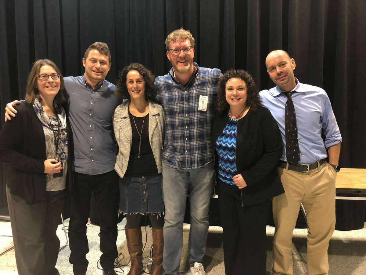 Ridgefield High School educators brought in New York Times best-selling author Brendan Kiely to discuss his novels All American Boys, The Last True Love Story, The Gospel of Winter and his most recent release, Tradition, with their 10th grade reading classes. Kiely, who has received numerous writing awards including Best Fiction for Young Adults (2015, 2017) by the American Library Association, later participated in a question and answer with students in the classroom. From left to right: Monica Housen, Adam Rapczynski, Judy Silver, the author, Donna DeMayo and Dave Griffith.