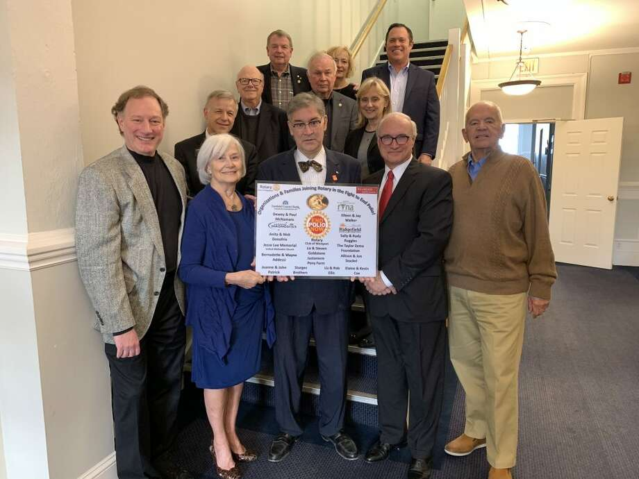 """National Polio Day was recognized on Oct. 24 by First Selectman Rudy Marconi and members of Ridgefield Rotary, who hung a plaque in town hall recognizing local efforts toward the """"International Eradicate Polio Initiative."""""""