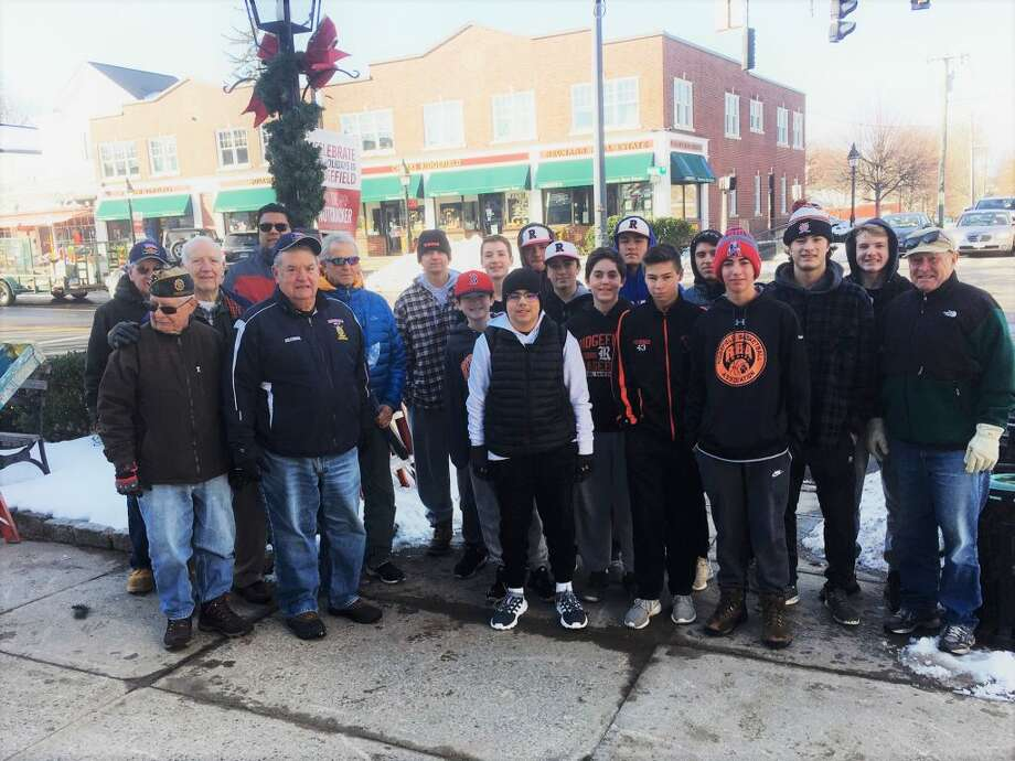 American Legion Post 78 members and baseball players they sponsor teamed up last weekend to decorate the lammposts around the village in time for the Festival of Lights in front of town hall Friday, Nov. 23.