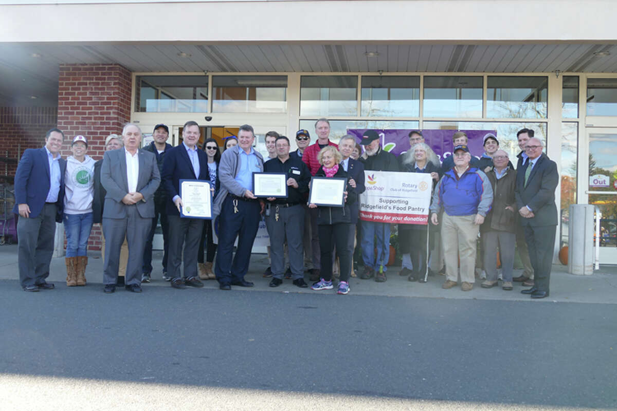 First Selectman Rudy Marconi and state Rep. John Frey gave the Rotary Club of Ridgefield a special recognition in front of Stop and Shop on Oct. 25 for racking up an estimated $500,000 in donated groceries from its monthly food drives. - Peter Yankowski photo
