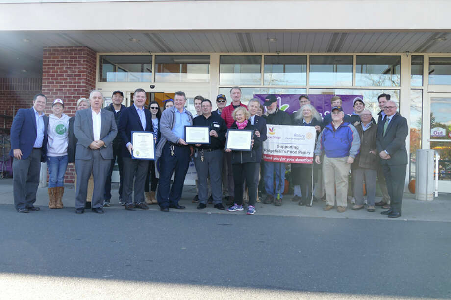 First Selectman Rudy Marconi and state Rep. John Frey gave the Rotary Club of Ridgefield a special recognition in front of Stop and Shop on Oct. 25 for racking up an estimated $500,000 in donated groceries from its monthly food drives. — Peter Yankowski photo