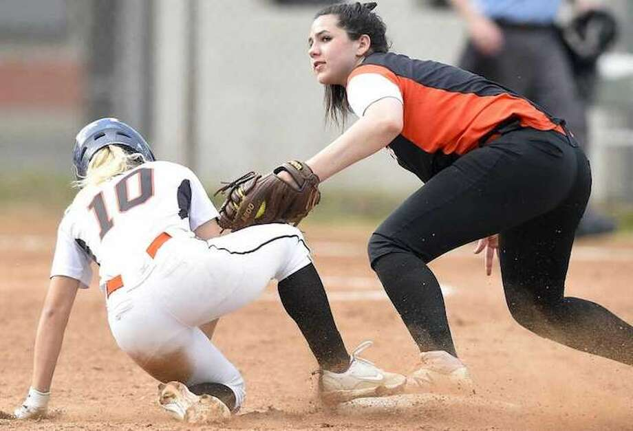 Ridgefield's Sabrina Grizzaffi is late with the tag on Stamford's Brycelin Stalteri during a play at second base in Friday's FCIAC quarterfinal game at Stamford High School. — Matthew Brown / Hearst Connecticut Media