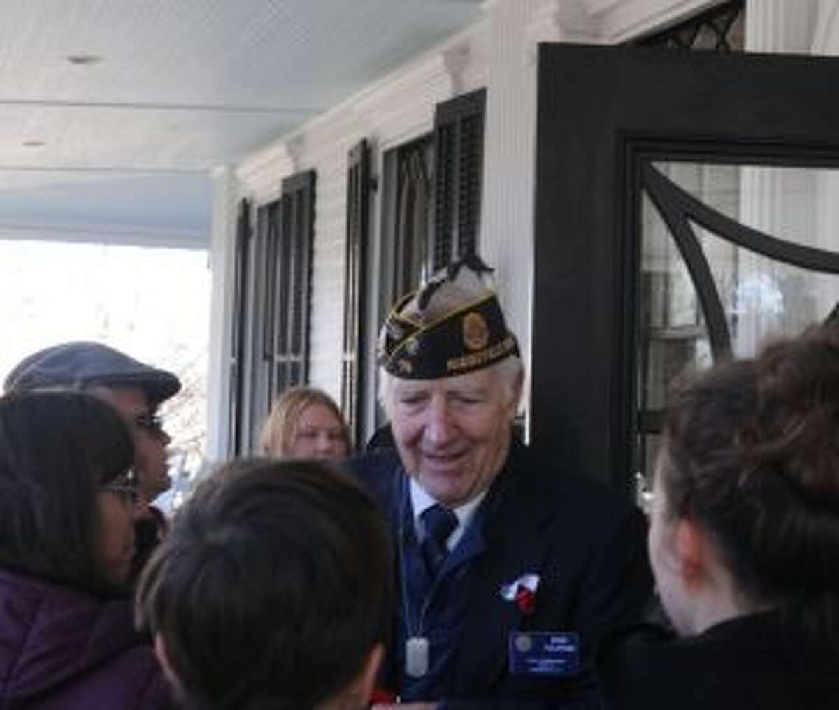 Keynote speaker bob Tuliipani was congratulated by friends after his speech at Veterans Day ceremonies.