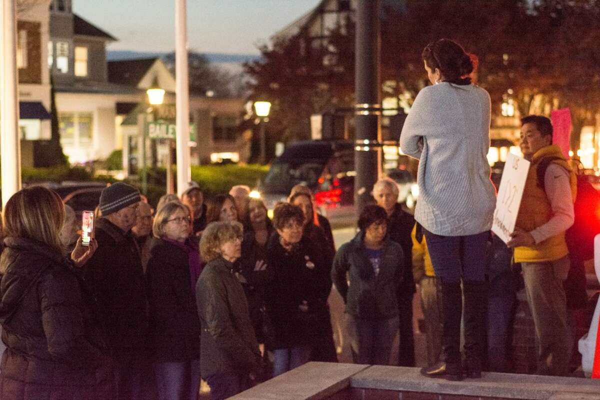 Aimee Berger-Girvalo stands in front of a crowd of residents who gathered Thursday night to attend a political rally in favor of the rule of law and against any potential effort by President Trump to shut down the Russia investigation. - Ian Murren photo
