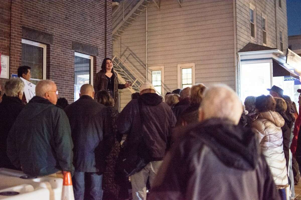 Ridgefield High School student Lane Murdock addresses a crowd of about 50 residents who gathered outside Town Hall Thursday night in protest of gun violence. -Ian Murren photo