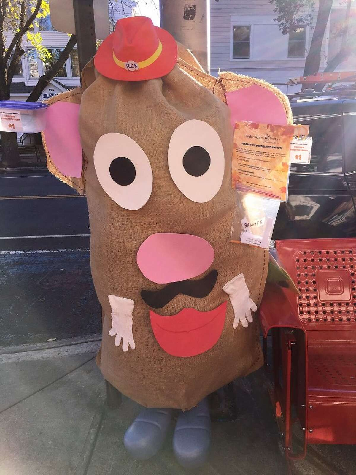 The Mr. Potato Head-themed scarecrow on Main Street in October.