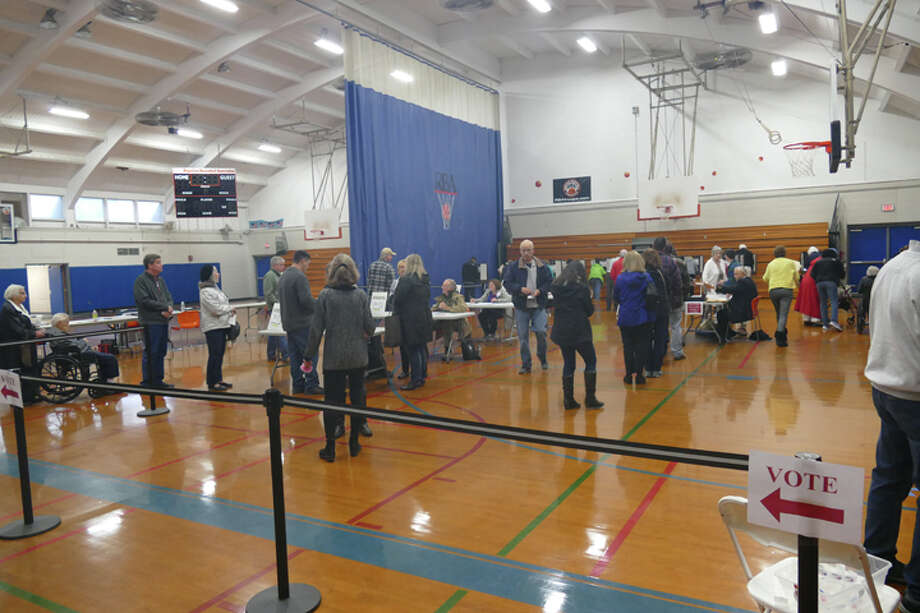 Yanity Gym saw more than 100 voters file in and out over a 15-minute span around 10 a.m. Tuesday, Nov. 6. Long lines of voters looking to cast their ballots have been reported at all three polling stations around town on Election Day. — Steve Coulter photo