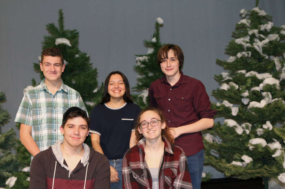 The lighting crew of the RHS production of Almost, Maine stands with trees being readied for the show's pine forest. Front row, left to right: DJ Ammirato and Emma Jaeger. Back row: Jonah Pereyra, Anna Sorgie and Dennis Dowding. — Tanya Jaeger photo