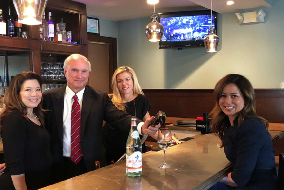 A guest bartending event at Gallo Ristorante will benefit Rides for Ridgefield. The bartenders include, from left to right: Kim Bova, executive director of the Ridgefield Chamber of Commerce; Rudy Marconi, Ridgefield's first selectman; Christine Mullen, president of the Chamber's Advisory Council; and Rosemarie Ferrante (seated), member of the Advisory Council.