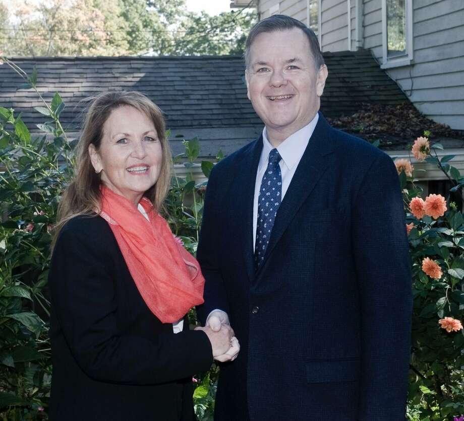Di Masters shakes hands with State RepresentativeJohn Frey. — Scott Mullin photo