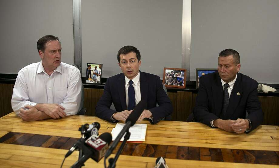 Mayor Pete Buttigieg (center) speaks during a news conference Sunday night in South Bend. He cut short a campaign trip after a South Bend police officer fatally shot a man earlier Sunday. Photo: Santiago Flores / South Bend Tribune