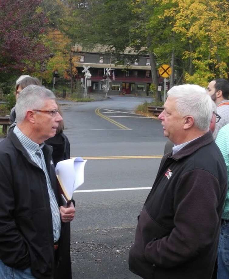 Recently retired town engineer Charlie Fisher, right, spoke with Selectman Bob Hebert in the fall of 2017, when town officials met area property owners to discuss the Branchville revitalization plan Fisher had put together. — Macklin Reid photo