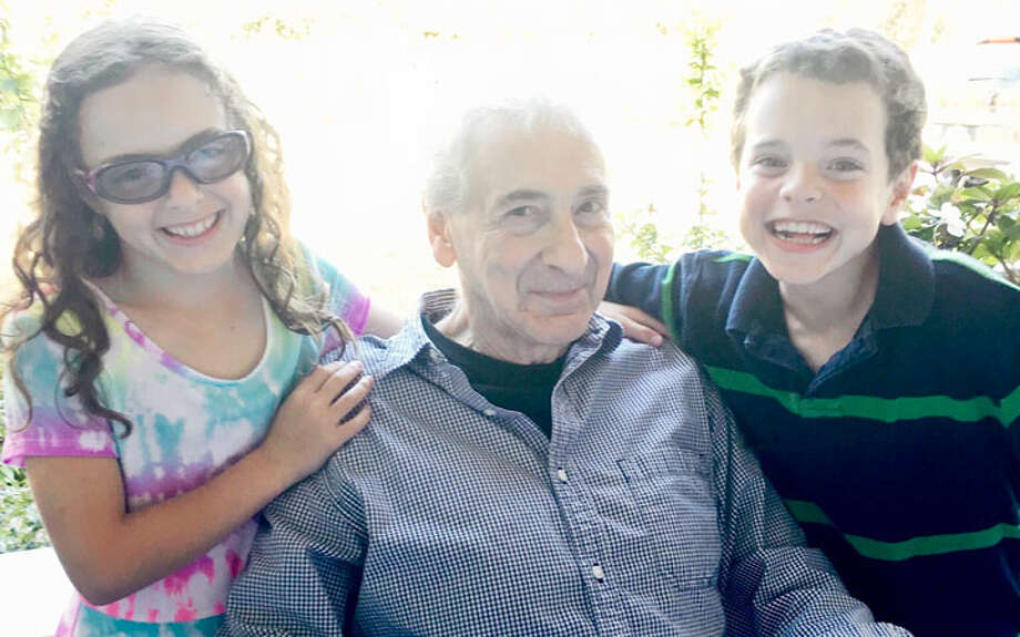 Stan Strauss with his grandchildren, Cate and Jake.