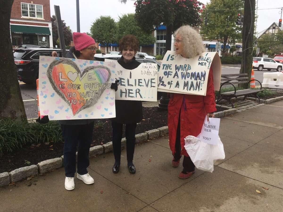 Ridgefield residents Alisa Trachtenberg, Kelly Breckinridge, andSuzanne Benton protest Judge Brett Kavanaugh's nomination to the Supreme Court on Main Street Friday, Sept. 28. - Peter Yankowski photo