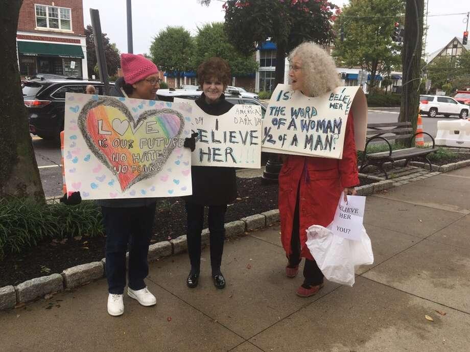 Ridgefield residents Alisa Trachtenberg, Kelly Breckinridge, andSuzanne Benton protest Judge Brett Kavanaugh's nomination to the Supreme Court on Main Street Friday, Sept. 28. — Peter Yankowski photo