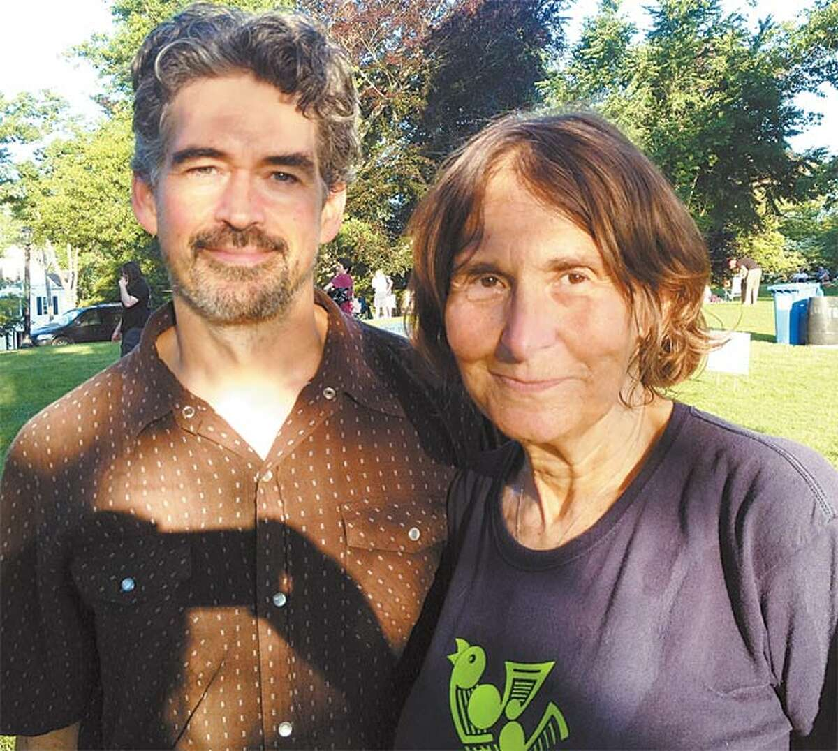 Barbara Manners with singer-songwriter Slaid Cleves before one of the free summer concerts she puts on in Ballard Park.