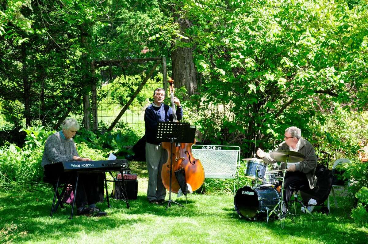 Musicians play at the Garden of Ideas, a 13-acre retreat of gardens, sculpture and walking paths beside Lake Mamanasco at 653 North Salem Road.