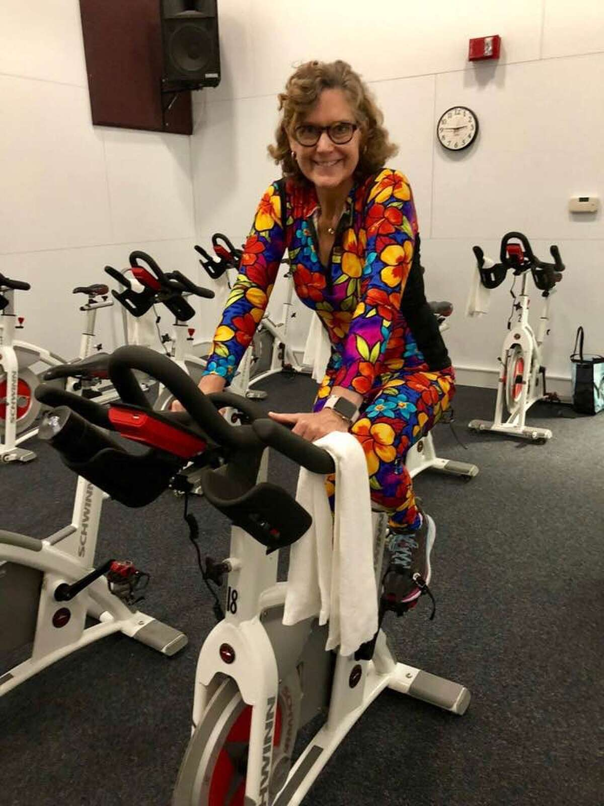 Ridgefield resident Marion Roth pedals on a stationary bike wearing workout clothes that she designed and made. Roth was diagnosed with a rare type of ovarian cancer in October 2016. She was successfully treated at The Praxair Cancer Center, part of Danbury Hospital. As part of National Ovarian Cancer Awareness Month this September, Roth is telling her story.