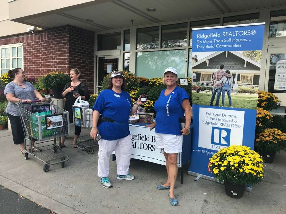 Colette Kabasakalian, director of community outreach for the Ridgefield Board of Realtors (RBOR), collects donated food with Mary Pat Sexton, the 2018 RBOR president.