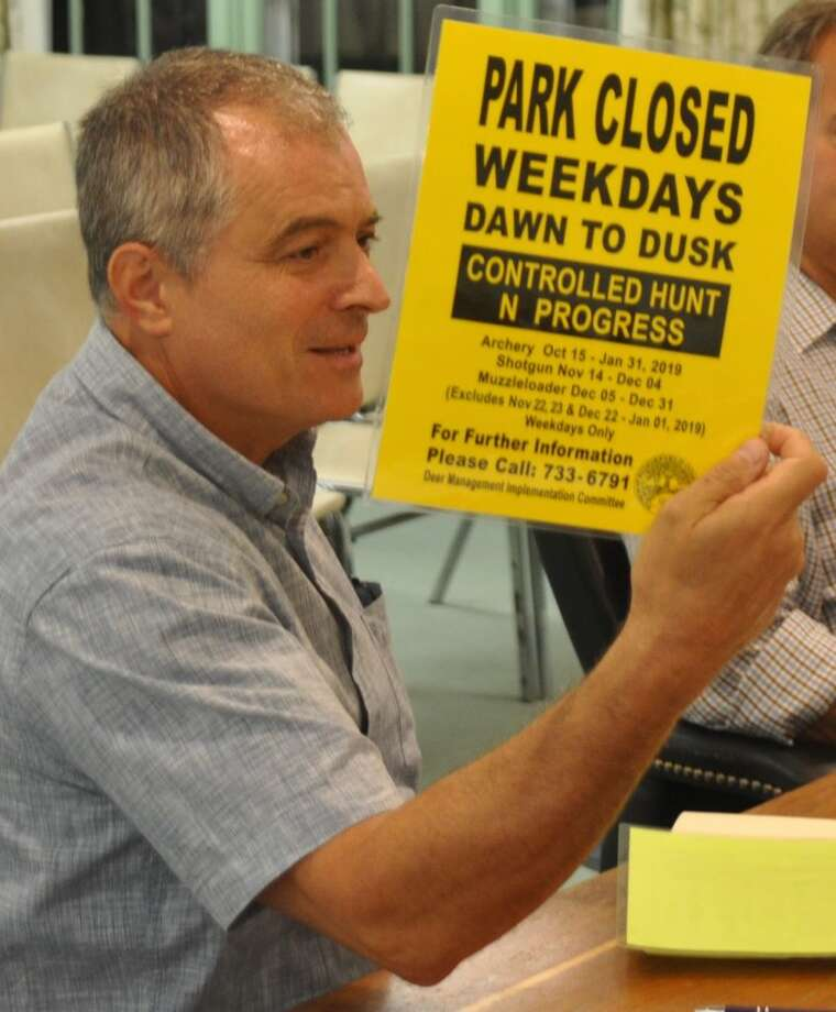 Stefano Zandri showed the Sept. 5 selectmen's meeting the type of sign the deer committee will have printed and laminated for posting on town lands to be hunted. — Macklin Reid photo