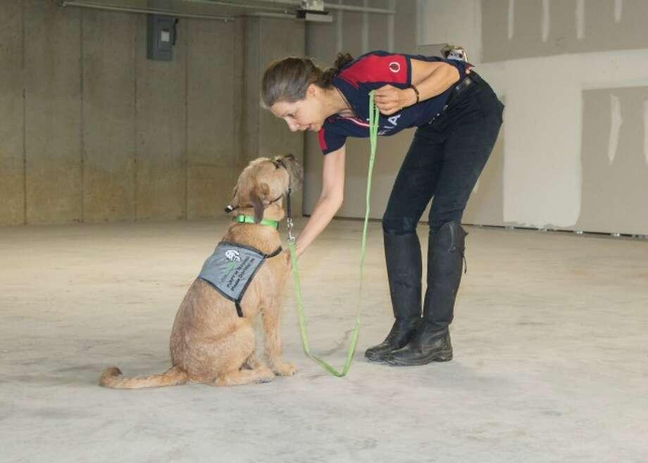 A Putnam Service Dogs puppy raiser with Benji.