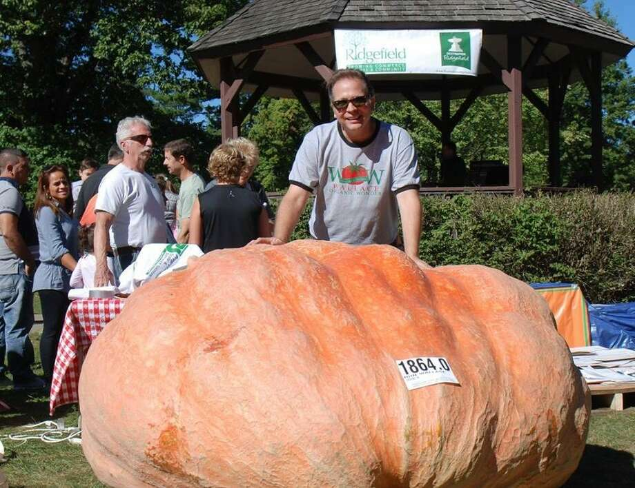 Ron Wallace of Greene, R.I., with his 1,864-pound pumpkin at the 2016 weigh-off for giant pumpkins in Ballard Park. — Jessica Collins photo