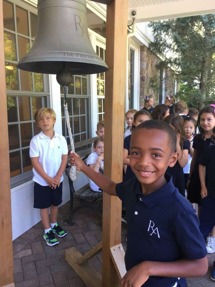 Ridgefield resident Oliver Howell rings in the school year with other Ridgefield Academy students.