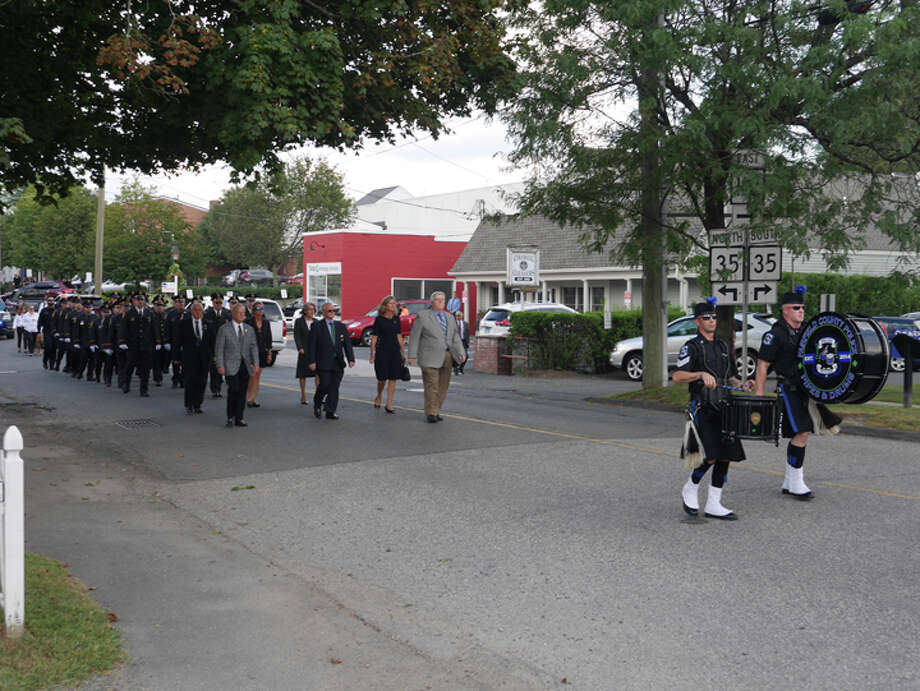 A procession before the wake of Ridgefield Police Chief John Roche closed down part of Catoonah Street Thursday afternoon. More traffic is expected on Catoonah and other village roads following the chief's funeral at 10:15.— Peter Yankowski photo