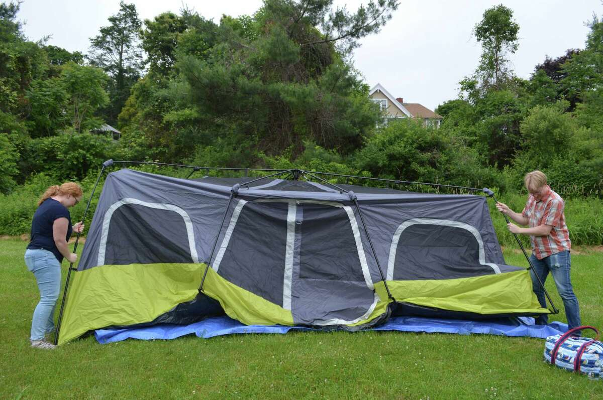 Lauren and Scott Briggs of Stamford set up their tent at the Great American Campout at the New Canaan Nature Center last year in New Canaan. The event returns June 22-June 23.