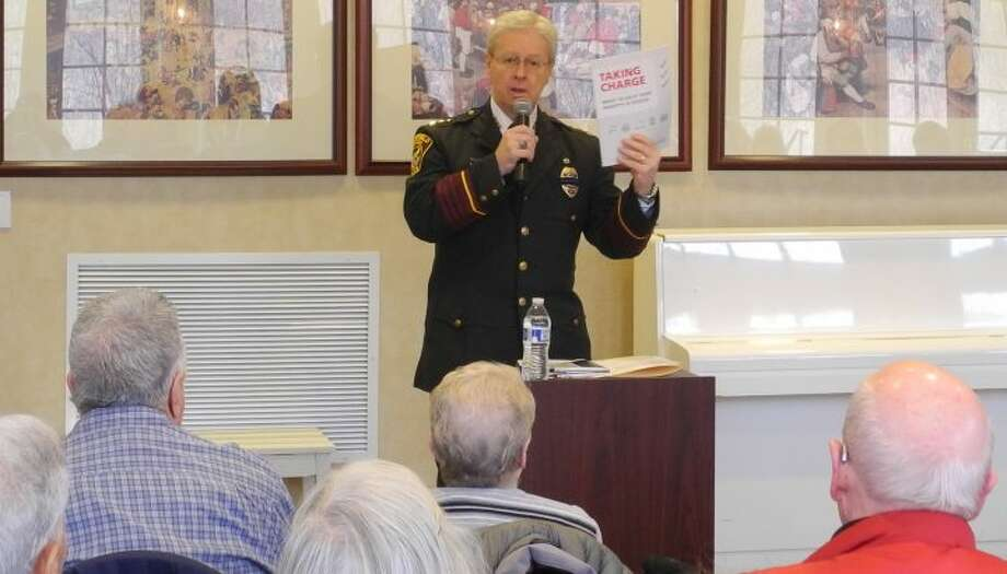 Ridgefield Police Chief John Roche discusses scams at Founders Hall in February 2017. He retired officially last Friday due to health reasons. — Macklin Reid photo