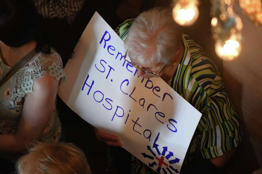 St. Clare's Hospital retirees and workers display signs during a press conference where lawmakers urged the state to launch an investigation of the hospital's pension fund collapse on Monday, June 17, 2019, at the Capitol in Albany, N.Y. Last year, over 1,000 former employees and retirees were notified their pensions would be eliminated or significantly decrease. (Will Waldron/Times Union) Photo: Will Waldron, Albany Times Union / 40047268A